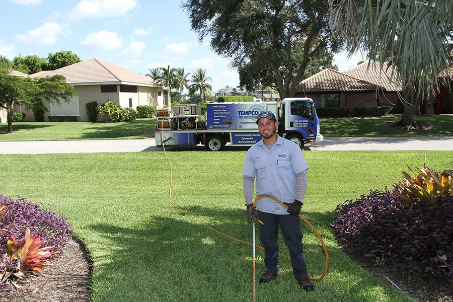 Tempco Lawn Care Tech and Truck treating client's lawns